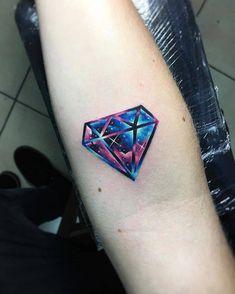 Galactic diamond tattoo on the inner forearm.