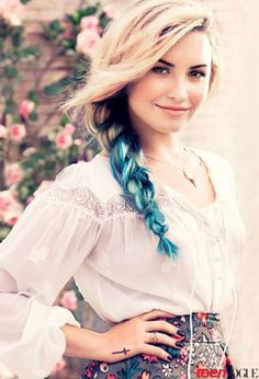 """Teen Vogue's shoot with Demi Lovato: """"With Demi Lovato's cover shoot taking place on a breezy ranch in Malibu, a cool California vibe was the inspiration for her hair. We wanted something soft and free-spirited... dip-dyed ends were loosely braided, forming a blond-to-aqua cascade of colors. Her shorter layers were perfectly undone and framed her face. It was dusty and natural."""""""