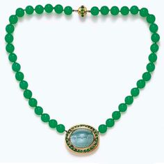 A GEM-SET PENDANT NECKLACE, BY PALOMA PICASSO, TIFFANY & CO.   Centering upon a polished gold bombé plaque, set with an oval-shaped cabochon cat's-eye aquamarine, within a circular-cut tsavorite garnet surround, to the single-strand chrysoprase bead necklace, measuring approximately 10.00 mm, to the polished gold and tsavorite garnet boule clasp, mounted in 18k gold, 19 ins., in a Tiffany & Co. black velvet fitted case  Signed Paloma Picasso, Tiffany & Co., no. 17529862