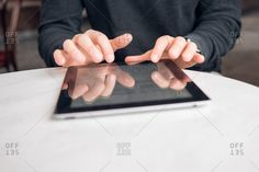 Young man typing on a tablet