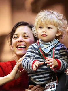 Marion Cotillard and 18 month, Marcel... um wow that is a gorgeous kid.
