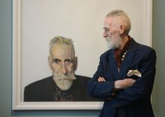 Artist dramatist and stage designer John Patrick Byrne (Scotish:1940) -  with one of his self portraits.