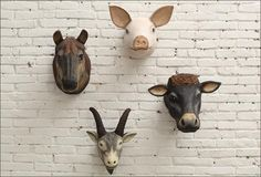 ANIMAL HEAD WALL MOUNTS  The secret to a stylish room? A variety of accents and touches that pulls it all together. We bring you today the absolute HOTTEST trend this coming Holiday Season. You'll start to see wall mount animal heads and trophies at all the posh furniture stores.  Whether you prefer them domesticated or not, have a great variety that will match any decor style. Huge cow heads, rams and pigs you be the judge!