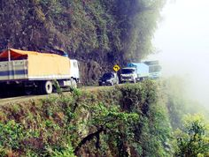 """Yungas Road (Road of Death), Bolivia -- Once named the """"world's most dangerous road,"""" El Camino de la Muerte is a 38-mile long journey through the mountains, leading from La Paz to Coroico. It is estimated that 200-300 travelers yearly die while traversing it."""