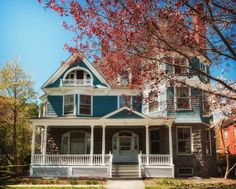 victorian house in teal and white