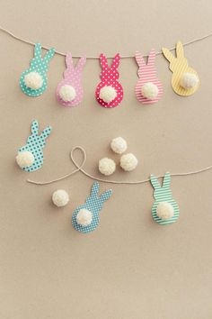 Easter Garland with Bunnies in a Few Easy Steps! - DIY Candy-Easter Garland with Bunnies in a Few Easy Steps! – DIY Candy This colorful Easter garland is so easy to make with scrapbook paper and yarn! Both kids and adults will love making this together. Bunny Crafts, Easter Crafts For Kids, Diy For Kids, Easter Ideas, Egg Crafts, Kids Fun, Unicorn Crafts, Preschool Crafts, Door Crafts