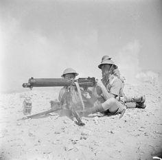 A Vickers machine gun team 'in action' near El Alamein, 17 July 1942.