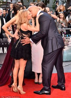 Sealed with a kiss: Kylie Minogue cosied up to co-star Dwayne Johnson at the San Andreas premiere in London on Thursday