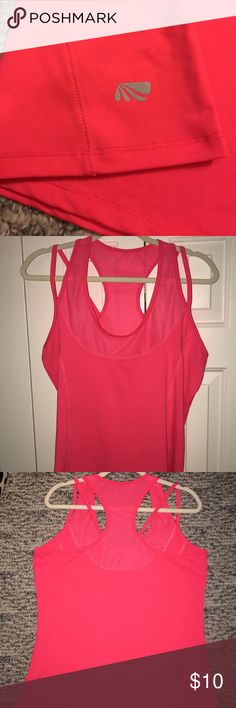Strapped Marika workout top Pink Marika workout tank, super lightweight with mesh along neckline. Cute strappy details. Re-posh, it was just too big on me. Tag removed by last owner. Marika Tops Tank Tops