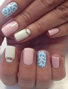 The perfect combination of colors and the right choice of designs make this manicure incredibly stylish. The classic nails' covering, is completed by fashi