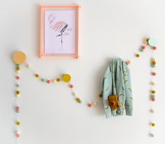 Wall Art Inspiration for a girls room or nursery,  Hooks by TheHookCo in natural, mustard and mint with LittlePuddles Felt Garland, Frame by Lecky Studio and flamingo print by Yorkelee Prints. Styling by Little Nook Interiors