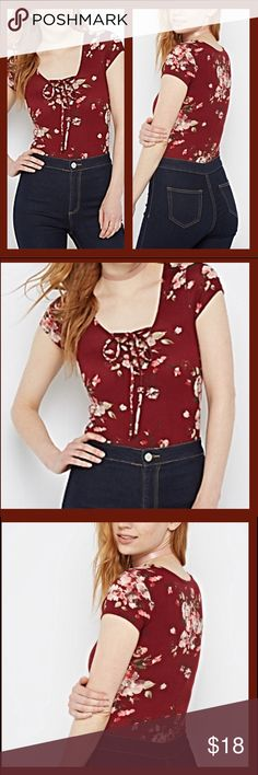 Burgundy floral bodysuit New with tags never worn buttons at bottom very clean Tops