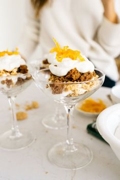 These orange carrot cake trifles are the perfect holiday dessert to serve up at parties. Just layer the cake with creamy filling and amaretti cookies!