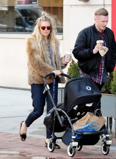 Sienna Miller in a fur coat, blue pants and leopard-print flats