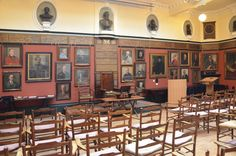 The Art Workers' Guild  In 1905 Voysey exhibited at Art Workers' Guild, Third Exhibition.  Its values include serving clients' needs in commissioned work rather than insisting on artistic autonomy, and collaboration between artists and designers in different fields, especially in the embellishment of buildings. Voysey is represented among the paintings of past members in the photo above.