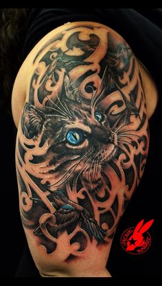 Amazing black & white cat with blue eyes tattoo