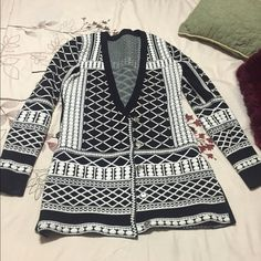 Black and white cardigan/dress studded Can be worn as a dress or cardigan. Black and white sweater material. Stretchy. With silver studs. Balmain inspired. Balmain Sweaters Cardigans