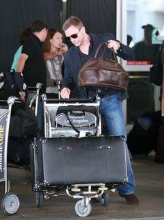 Daniel Craig with his Globe-Trotter Black Centenary Suitcase