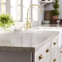 Unlike granite, engineered quartz has a uniform appearance and a nonporous surface that holds up well against heat and stains, and quartz costs about the same as midrange granite. Plus, granite needs to be sealed a few times per year, while quartz does not. We love this quartz countertop in Flagstone from Martha Stewart Living™, available exclusively at The Home Depot.