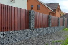 gabion timber fence - 2' stone, 4' horizontal slats