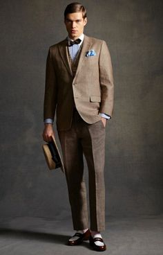 Costume designer Catherine Martin not only based the film's 500-piece wardrobe off Brooks Brothers' early 1920s catalogue, the tailoring brand made costumes for the film too. Modern gents can get into the Twenties spirit with the Brooks Brothers Great Gatsby collection, pictured here.  Wool and Linen Jacket, $698; Tattersall Vest $248; Brown, Red and White Lattice Bow, $55; White and Brown Spectator Loafer, $598; Brooks Brothers