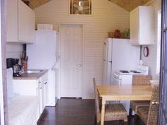 How to Live in 320 Square Feet: Our Cottages. Blog featuring downsizing, substitutes for consumerism, voluntary simplicity, small houses. Freaking love it!!! So cute!