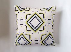 White Linen Tribal Print Pillow Cover  This pillow cover is made with a heavyweight white linen with a black, yellow and light turquoise print. It