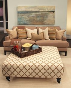 an oversized tufted ottoman with plush velvet sofas with modern