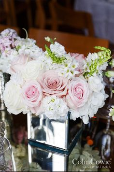 Pink and white roses in mirrored vase - beautiful wedding centerpiece!  ~  we ❤ this! moncheribridals.com