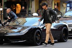 Mesut Ozil with his Ferrari 458
