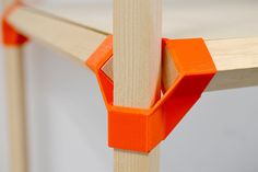 A connector to build everything from a table to a shelf.