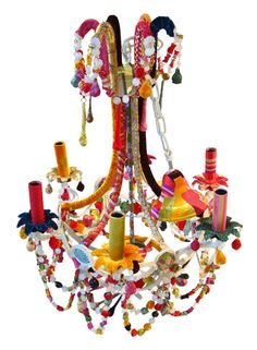 The Cut Glass Chandelier The cut glass Chandelier to order wrapped in single colour velvets or patch work fabrics, by the nature of the patchworked process no two pieces are exactly the same. Fabrics used include woven silks, velvets and printed and woven cottons.