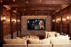 Home Design. Natural Home Movie Theater Rooms With Rustic Wooden Walls And Beige Sectional Couch Combined Cushions Also Rounded Rattan Table Featuring LCD TV Mounted On Natural Stone Wall And Romantic Recessed Ceiling Lighting Incorporates Massive Lantern Ideas. Stunning Movie Theater Rooms For Your Home Entertainment