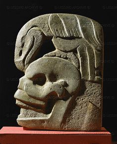 MAYA SCULPTURE 7TH     Hacha, a flat, highly polished sculpture associated with the Maya ballgame. This hacha shows a bird of prey on a skull. Hachas may have been markers, or trophies, or models for the players leather belts (600-900 CE). Volcanic stone. Height 29.5 cm, from Guatemala.     Museo Nacional de Arqueologia, Guatemala City, Guatemala