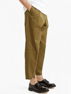 J.W. Anderson Khaki Pleated Cotton Trousers The J.W. Anderson Pleated Cotton Trousers for SS17, seen here in khaki. - - Crafted from premium cotton and cut to offer a relaxed fit, these straight-leg trousers from J.W. Anderson feature a pleat t http://www.MightGet.com/january-2017-13/j-w-anderson-khaki-pleated-cotton-trousers.asp