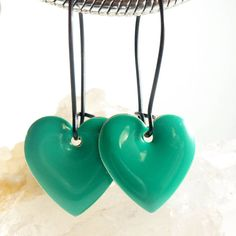 Great way to make a simple statement with these green dangle heart earrings!  #jewelry #jewelrygram #earrings #accessories #fashion #style #luxurystyle #instajewelry #jewelryforsale #selfmade #etsyhandmade #etsyjewelry #etsyseller #bling #design #instadaily #jewelrygram #new #etsy #selfemployed #usa #madeinusa #pottiteam #enchantedroseshop #MNTTOI #fashionjewelry #fashion #dressedup #ontrend #boutiques