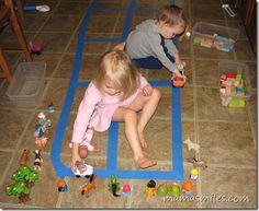 #creative magic with painter's tape, blocks, and small toys