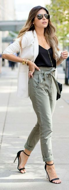 Woman wearing green tie pants, with black cami and white blazer, great for casual work attire | Skirt the ceiling @ skirt the ceiling.com