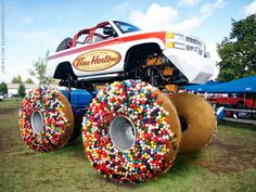 Whoever thought of having a monster truck with Tim Horton's doughnuts as wheels? Jacked Up Trucks, Cool Trucks, Big Trucks, Pickup Trucks, Cool Cars, Chevy Trucks, Redneck Trucks, Strange Cars, Weird Cars