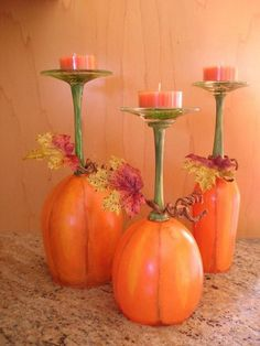Pumpkin Patch Wine Glass Candle. Paint wine glasses like pumpkins, wrap leaves or garland around top of stem, and place them upside down to use as candle holders! They surely add a touch of autumn to your fall table decoration.