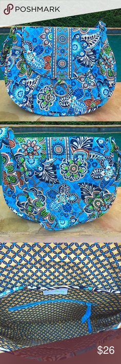 """Vera Bradley Bali Blue Cross body Stylish Vera Bradley Saddle Up Bag in retired Bali blue. Never used. New without tag.   The Saddle Up measures 13"""" x 10"""" x 4"""" with an adjustable shoulder strap that can be lengthened to wear cross body. It features a flap with a hidden magnetic closure, silver-tone embossed hardware, five interior slip pockets, and one interior zip pocket Vera Bradley Bags Crossbody Bags"""
