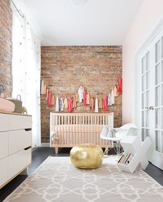 Lovely Nursery with Metallic Gold Pouf Accent and DIY Bunting