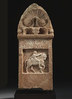 A GREEK MARBLE GRAVE STELE FOR LYSON CLASSICAL PERIOD, CIRCA 4TH CENTURY B.C.