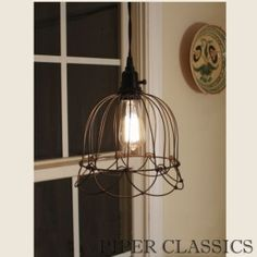 """Bell Pendant Lamp with Rustic finish - a rusty brown/black finish with a hint of green """"verdigris"""" in the finish."""