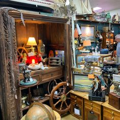 We have an endless supply of nautical antiques for all of your nautical decor including outboard motors, mermaid bronze statues, authentic Ships Wheel's and lanterns. Come see it for yourself at Gannons Antiques and Art Vendor Displays, Ship Wheel, Outboard Motors, Antique Art, Statues, 1920s, Lanterns, Home Goods, Nautical