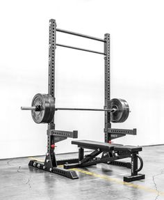 rouge squat rack...plus bar with rubber plates.