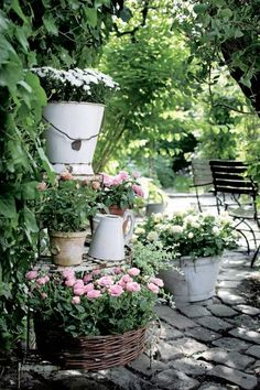 Use old enamel containers for potted plants on your porch