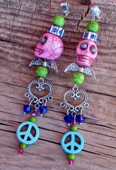 COWGIRL GYPSY Pink Turquoise Skull Lime Green  and Aqua Turquoise Peace Blue Crystal & Rhinestone Silver Angel Wing & Skull Long Western Earrings by CowgirlsUntamed  $34.50 plus shipping See on etsy, Facebook or our website: www.cowgirlsuntamed.com