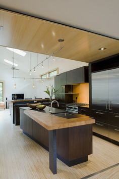 S&D Bamboo countertops -eco-friendly, cost $26 to$36 square ft. One of the harder woods. How does it hold up to water and heat??contemporary kitchen by Gardner Mohr Architects LLC