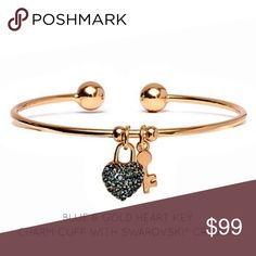 🔜Heart Key Charm Cuff With Swarovski® Crystal PRODUCT DESCRIPTION:  An encrusted heart and key charm adorned with crystals from Swarovski® decorate this slender 18-karat gold-plated cuff with a sophisticated touch of detail. 7.2'' circumference x 0.2'' W Pendant: 0.8'' L 18k gold-plated brass / Swarovski® crystal Imported Janis Boutique  Jewelry Bracelets